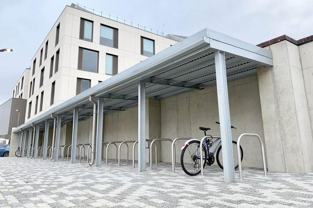 Sheltered Parking for 50 Bikes with Living Roof right outside the Senate Building of University of Northampton